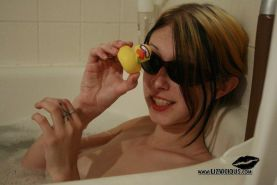 Pictures of Liz Vicious taking a bath in her sunglasses