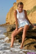 Pictures of teen model Kristina Fey showing off her long legs outside