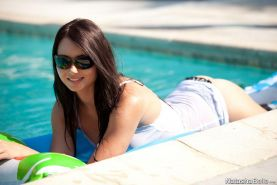 Pictures of Natasha Belle having fun in the pool