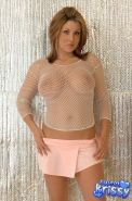 Busty babe Sweet Krissy poses in a sheer top and pink skirt