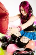 Pictures of Miss Kitty playing with balloons