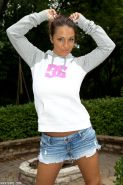 Sporty girl Nikki Sims strips for you outside in a ponytail