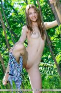 Brunette teen Izabel A strips naked outside for you