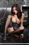 Stunning girl Michaela Isizzu gets naughty with leather and chains