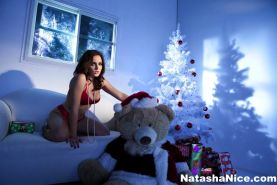 Horny thief Natasha breaks into a cozy home and uses Christmas gifts to satisfy her urges.