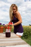 Blonde country girl Madden tends to her flowers outside