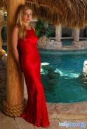 Pictures of teen Kelly Brooke slipping out of her sexy red dress