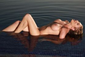 Busty blonde hottie Lexi Lowe gets naked and wet in the lake