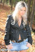 Ann Angel goes for a walk in her jean miniskirt and leather jacket