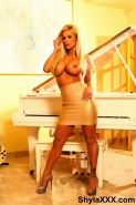 Shyla poses glam style in this hot and sexy piano set.