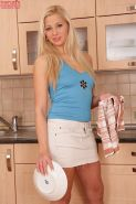 Blonde teen Candy Caine fingers her tight pussy in the kitchen