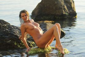 Blonde hottie Nik gets naked and goes for a swim