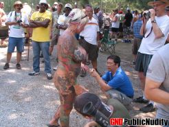Random naked people at an outdoor public nudity party