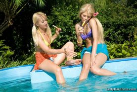 Pictures of teen girl Lolly Hardcore enjoying pussy by the pool