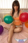 Pictures of a brunette teen playing with balloons