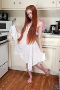 Redhead teen Dolly Little has something tasty for you in the kitchen