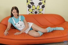 Nubile hottie in long socks tickles her pussy with the magic wand