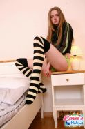 Pictures of teen amateur Ema's Place teasing in striped socks