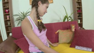 Pictures of teen girl Abelinda toying her swollen clit