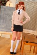 Redhead schoolgirl Elle Richie gets naughty in the classroom
