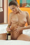 Busty beauty Vanda B enjoys a glass of wine and fucks herself with the bottle