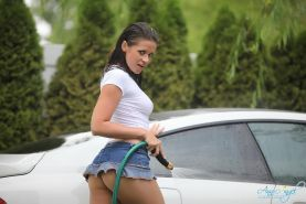Pictures of Ann Angel getting wet in a sexy car wash
