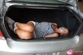 Pictures of teen girl Craving Carmen tied up in the trunk of a car