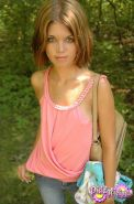 Brunette teen Diddy teases in her pink tank top and jeans in the woods