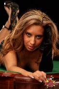 Pictures of Pam Rodriguez flaunting her body on a pool table