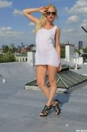 Gorgeous blonde Shelly strips out of her wet t-shirt on the roof top