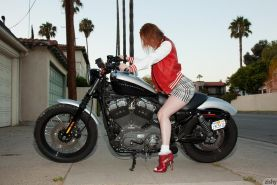 Redhead teen Lilith Lust teases in her college uniform
