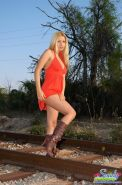 Pictures of teen girl Sandy Summers all nude on the train tracks