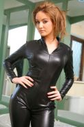 Kinky redhead flaunts her sexy curves in a skin tight black catsuit and black pantyhose.