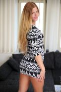 Redhead teen Chrissy Fox fondles her tight pussy on the couch