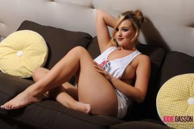 Jodie Gasson shows you her pretty legs and big boobs on the couch