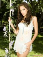 Pictures of the beautiful Jenna Haze taking off her clothes in the garden