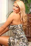 Busty blonde Ember Reigns strips out of her animal-print dress