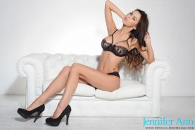 Glam babe Jennifer Ann shows off her big boobs on the couch