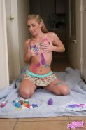 Abbie gets naughty with finger paint all over her perky tits and round ass
