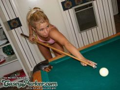 Pictures of two lesbian teens being naughty on a pool table
