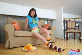 Pictures of teen model Little Caprice fucking herself with a banana
