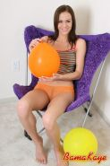 Pictures of teen girl Bama Kaye playing with balloons