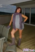 Pregnant teen Candy in her gloves scarf and booties