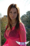 Pictures of a brunette teen showing off her bra