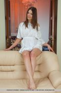 Pretty teen Carlina strips completely naked for you on the couch
