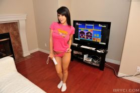 Pictures of Bryci having fun with her wii