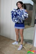 Sexy tease Mai Ly plays around in her cute cheerleader costume that she strips out of