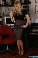 Pictures of teen amateur Malloy Martin being a naughty secretary