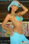 Pictures of Karla Spice wearing a very skimpy and tight string bikini