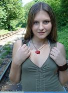 Pictures of teen Josie Model exposing herself on a train track
